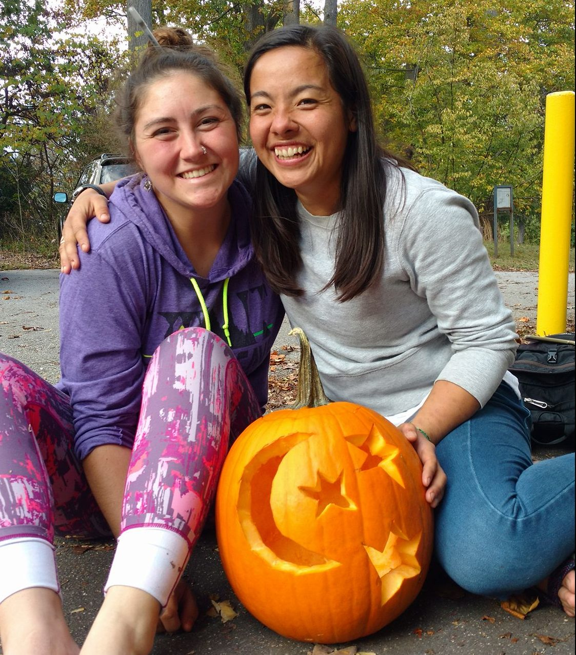 Katie and Yoshie Carving Pumpkins